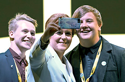 SNP Spring Conference, Saturday 27th April 2019<br /> <br /> Pictured: First Minister Nicola Sturgeon takes selfies with the crowd at conference<br /> <br /> Alex Todd | Edinburgh Elite media