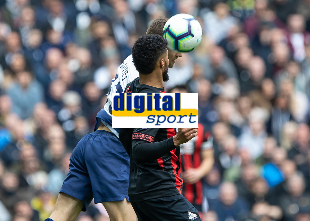 Football - 2018 / 2019 Premier League - Tottenham Hotspur vs. Huddersfield Town<br /> <br /> Ben Davies (Tottenham FC)  and Elias Kachunga (Huddersfield Town) compete for the header at The Tottenham Hotspur Stadium.<br /> <br /> COLORSPORT/DANIEL BEARHAM