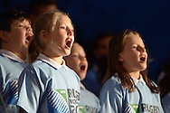 A school choir sings World in Union. RWC 2015, Coca Cola London Eye launch for the Rugby World cup event  in London on Tuesday 15th Sept  2015.<br /> pic by John Patrick Fletcher, Andrew Orchard sports photography.