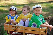 27 March 2010 : Children dressed to the hilt enjoy the weather outside of the paddock while waiting for the first race.