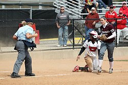 06 April 2013:  Jhavon Hamilton gets called out at third by home plate umpire Sally Keller after being tagged by  Heather Duckworth during an NCAA Division 1 Missouri Valley Conference (MVC) women's softball game between the Drake Bulldogs and the Illinois State Redbirds on Marian Kneer Field in Normal IL