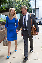 © Licensed to London News Pictures. 15/08/2017. LONDON, UK.  CRAIG MACKINLAY, Conservative MP for South Thanet<br /> with his wife, Kati  leaving Southwark Crown Court after a Plea and Trial Preparation Hearing (PTPH). CRAIG MACKINLAY, Conservative MP for South Thanet, MARION LITTLE, Craig Mackinlay's campaign director and NATHAN GRAY, Craig Mackinlay's election agent have each been charged with offences under the Representation of the People Act 1983.  Photo credit: Vickie Flores/LNP