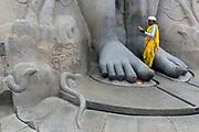 A Jain pilgrim makes a prayer at the  Bahubali Gommateshwara Statue, Shravanabelagola
