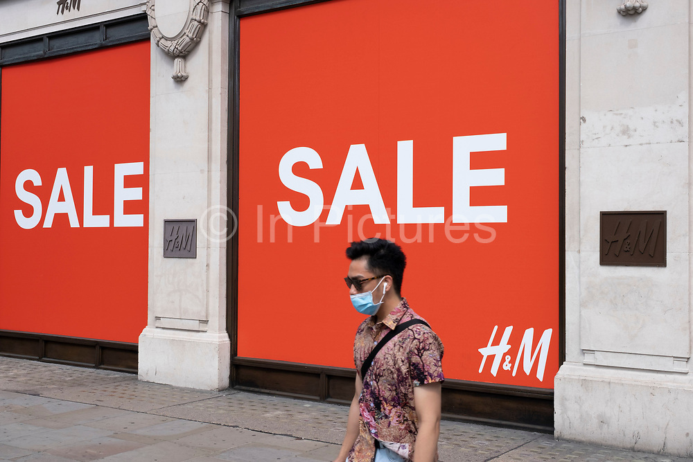 As Britain enters a period of deep recession, with some shops closing either temporarily or permanently as the economic downturn caused by the Covid-19 pandemic cuts hard, shoppers wearing face masks continue to come to the West End to Oxford Street while shops massively reduce prices in a wave of sales on 13th August 2020 in London, United Kingdom. The Office for National Statistics / ONS has announced that gross domestic product / GDP, the widest gauge of economic health, fell by 20.4% in the second quarter of the year, compared with the previous quarter. This is the biggest decline since records began. The result is that Britain has officially entered recession, as the UK economy shrank more than any other major economy during the coronavirus outbreak.