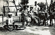 Western people on terrace with Moroccan cook Morocco 1930s