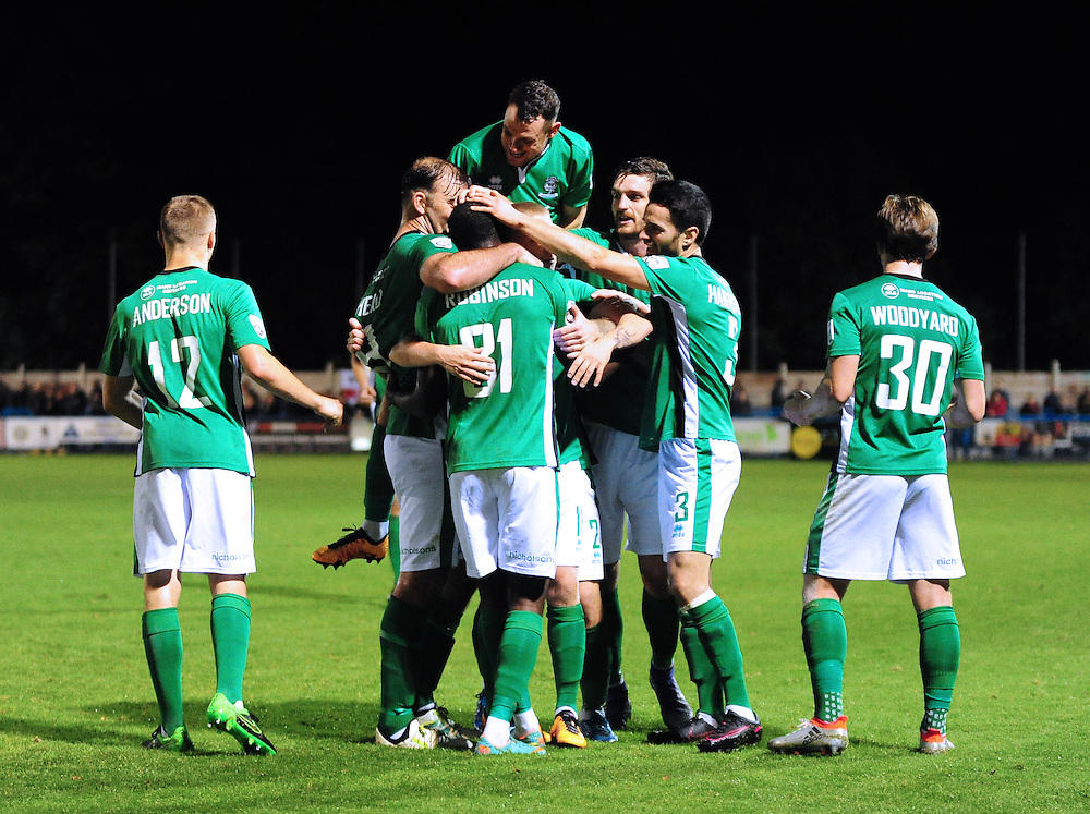 Lincoln City's Theo Robinson celebrates scoring the opening goal with team mates<br /> <br /> Photographer Andrew Vaughan/CameraSport<br /> <br /> Football - The Emirates FA Cup 4th Qualifying Round Replay - Guiseley v Lincoln City - Tuesday 18th October 2016 - Nethermore Park - Guiseley<br />  <br /> World Copyright © 2016 CameraSport. All rights reserved. 43 Linden Ave. Countesthorpe. Leicester. England. LE8 5PG - Tel: +44 (0) 116 277 4147 - admin@camerasport.com - www.camerasport.com