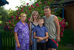 Vita Kalembet, a paralegal, is seen with her family in Poltava, Ukraine, June 18, 2011. Kalembet spends her days helping her neighbors with legal advice while caring for her husband, Anatoli Kalembet, son, Vladislav Kalembet, 10, and grandmother, Katarina Pereyatenets, 66. More than half of the worldÕs population, four billion people live outside the rule of law, with no effective title to property, access to courts or redress for official abuse. The Open Society Justice Initiative is involved in building capacity and developing pilot programs through the use of community-based advocates and paralegals in Sierra Leone, Ukraine and Indonesia. The pilot programs, which combine education with grassroots tools to provide concrete solutions to instances of injustice, help give poor people some measure of control over their lives.