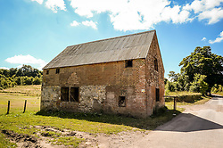 A building at Seagram's Farm in Imber village on Salisbury Plain, Wiltshire, where residents were evicted in 1943 to provide an exercise area for US troops preparing to invade Europe. Roads through the MoD controlled village are now open and will close again on Monday August 22.
