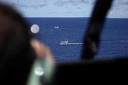 INDIAN OCEAN 24MAR13 - Spotting unidentified Sri Lankan fishing vessels from the helicopter in the Chagos EEZ in the Indian Ocean.<br /> <br /> <br /> <br /> The Greenpeace ship Esperanza is on patrol in the Indian ocean documenting illegal fishing vessels.<br /> <br /> <br /> <br /> jre/Photo by Jiri Rezac / Greenpeace