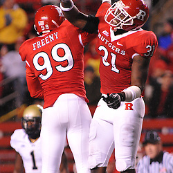 Oct 16, 2009; Piscataway, NJ, USA; Rutgers defensive end Jonathan Freeny (99) and Rutgers defensive end George Johnson (31) celebrate a defensive stop during first half NCAA football action in Pittsburgh's 24-17 victory over Rutgers at Rutgers Stadium.