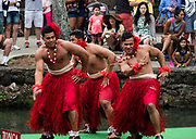 """Dancing of Tonga in the Canoe Pageant, """"Rainbows of Paradise."""" The Polynesian Cultural Center (PCC) is a major theme park and living museum, in Laie on the northeast coast (Windward Side) of the island of Oahu, Hawaii, USA. The PCC first opened in 1963 as a way for students at the adjacent Church College of Hawaii (now Brigham Young University Hawaii) to earn money for their education and as a means to preserve and portray the cultures of the people of Polynesia. Performers demonstrate Polynesian arts and crafts within simulated tropical villages, covering Hawaii, Aotearoa (New Zealand), Fiji, Samoa, Tahiti, Tonga and the Marquesas Islands. The Rapa Nui (Easter Island) exhibit features seven hand-carved moai (stone statues). The PCC is run by the Church of Jesus Christ of Latter-day Saints (LDS Church). For this photo's licensing options, please inquire."""