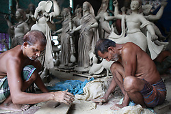 September 23, 2016 - Dhaka, Bangladesh - Bangladeshi artists work on clay idol of the Hindu Goddess Durga in preparation for the upcoming Hindu religious festival Durga Puja in Old, Bangladesh, September 23, 2016. Durga Puja or Sharadotsav is an annual Hindu festival in South Asia that celebrates worship of the Hindu goddess Durga. The annual five-day Hindu festival worships the goddess Durga, who symbolizes power and the triumph of good over evil in Hindu mythology. (Credit Image: © Suvra Kanti Das via ZUMA Wire)