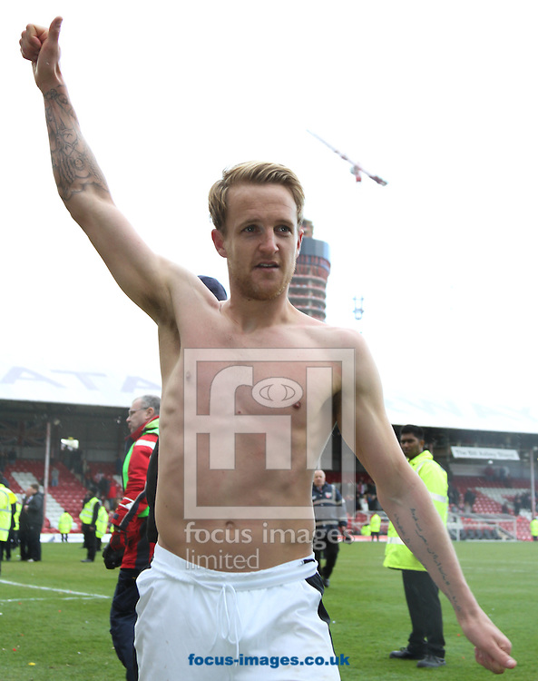 Picture by David Horn/Focus Images Ltd +44 7545 970036.27/04/2013.James Coppingger of Doncaster Rovers, scorer of their only goal celebrates the win after the npower League 1 match at Griffin Park, London.