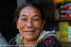 Woman in Nuwakot on a walk through the village during Motorcycle Sherpa's Ride to the Heavens motorcycle adventure in the Himalayas of Nepal. This first day of riding took us from Kathmandu to Nuwakot. Monday, November 4, 2019. Photography ©2019 Michael Lichter.