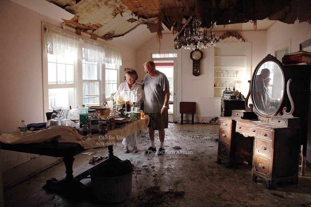 Mary and Greg Kergosien,married for 55 yrs. rs in Bay St. Louis Saturday Sept. 10,2005. The Kergosiens rode the storm out in their 100year old home, where Greg was born, and have begun the long process of cleaning up after Katrina.Photo©SuziAltman