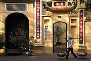 A vendor passes Ly Quoc Su Pagoda, in the Old Quarter.
