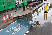 A cyclist rides on the pavement while a section of the CS2 cycling superhighway is blocked due to recent rainfall, on 29th August 2018, in London, England. The CS2 cycle route is about 4.3 miles 6.8 kilometres, from Stratford to Aldgate.