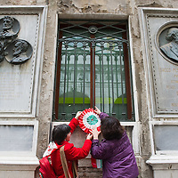 VENICE, ITALY - MARCH 17:  A rosette with the colours of the Italian national flag is hang under the stone commemorating martyrs of the Risorgimento on the day of the celebrations for the 150th anniversary of Italy's unification on March 17, 2011 in Venice, Italy. Events in various Italian cities will celebrate the 150th anniversary of Italy's unification until the end of the year. National Festivity begins on March 17.
