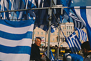 Greek flags on sale in front of the national parliment building in central Athens, Greece. Syntagma square was host to a large pro-government rally in support of the recently elected Syriza party's anti-austerity stance towards Europe.