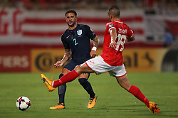 England's Kyle Walker and Malta's Joe Zerafa battle for the ball during the 2018 FIFA World Cup Qualifying, Group F match at the National Stadium, Ta' Qali. PRESS ASSOCIATION Photo. Picture date: Friday September 1, 2017. See PA story SOCCER Malta. Photo credit should read: Nick Potts/PA Wire. RESTRICTIONS: Use subject to FA restrictions. Editorial use only. Commercial use only with prior written consent of the FA. No editing except cropping.