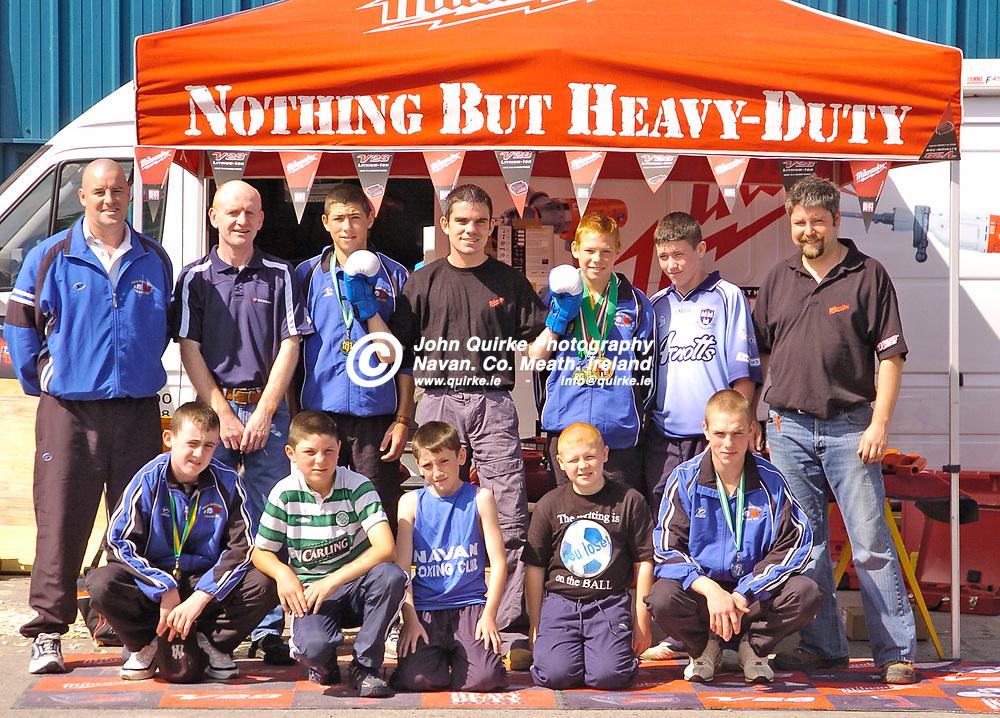 10/8/05 - Irish Featherweight champion Bernard Dunne visits Commons Hardware, Navan.<br /> Bernard Dunne photographed with Navan Boxing club members back row from L to R: Neil Blayney (Coach and trainer), George Gibney (Coach and trainer), John Joyce, Bernard Dunne, Christopher Blayney, Brian Johnston, John OByrne (Commons Hardware).<br /> Front row from L to R: Jonathan Smith, Joe Joyce, Jason Gibney, David Hilliard and Daniel Blayney.<br /> Photo:Barry Cronin/www.quirke.ie