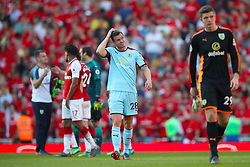 Burnley's Kevin Long (centre) shows his dejection after the final whistle