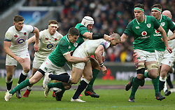 England's Mike Brown is tackled during the NatWest 6 Nations match at Twickenham Stadium, London.
