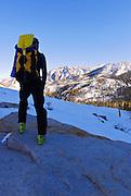Backcountry skier enjoying the view below Piute Pass, Inyo National Forest, Sierra Nevada Mountains, California