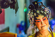 27 APRIL 2013 - BANGKOK, THAILAND: A portrait of a Chinese opera performer backstage at a Chinese opera in the Talat Noi neighborhood of Bangkok's Chinatown. Chinese opera was once very popular in Thailand and is usually performed in the Teochew language. Millions of Chinese emigrated to Thailand (then Siam) in the 18th and 19th centuries and brought their cultural practices with them. Recently its popularity has faded as people turn to performances of opera on DVD or movies. There are as many 30 Chinese opera troupes left in Bangkok. They travel from Chinese temple to Chinese temple performing on stages they put up in streets near the temple, sometimes sleeping on hammocks they sling under their stage. The opera troupes are paid by the temple, usually $700 to $1000 a night.   PHOTO BY JACK KURTZ