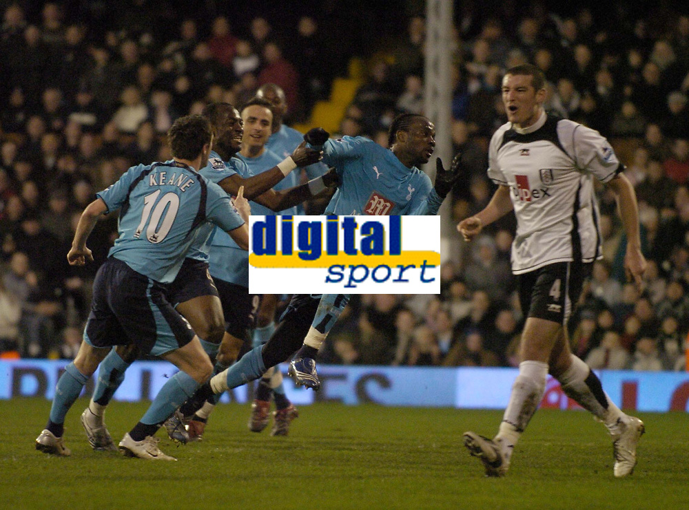 Photo: Olly Greenwood.<br />Fulham v Tottenham Hotspur. The Barclays Premiership. 20/01/2007. Tottenham's Pascal Chimbonda celebrates scoring while Fulham's Franck Quedrue looks at the linesman for offside