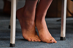 The Duchess of Sussex removes her shoes during a visit to Te Papaiouru, Ohinemutu, in Rotorua, before a lunch in honour of Harry and Meghan, on day four of the royal couple's tour of New Zealand.