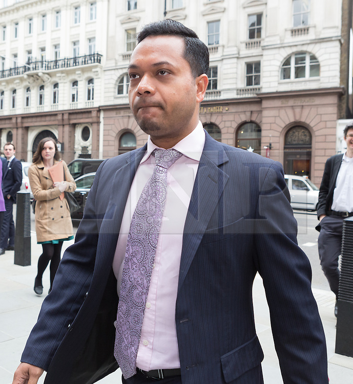 © Licensed to London News Pictures. 23/04/2015. London, UK. Deputy Mayor of Tower Hamlets, Oliur Rahman arrives at the Royal Courts of Justice, High Court in London for the ruling of the Tower Hamlets election petition trial. The election petition, brought by four residents, which is led by Andrew Erlam against Lutfur Rahman seeks a re-run of last May's mayoral election in the east London borough of Tower Hamlets.. Photo credit : Vickie Flores/LNP