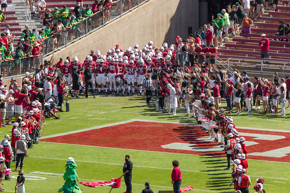 PALO ALTO, CA - OCTOBER 2:  The Stanford Cardinal football team and Head Coach David Shaw (wearing black) enter the field before a Pac-12 football game against the Oregon Ducks on October 2, 2021 at Stanford Stadium in Palo Alto, California.  (Photo by David Madison/Getty Images)