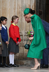 The Duke and Duchess of Sussex speak to school children as they leave after the Commonwealth Service at Westminster Abbey, London on Commonwealth Day. The service is the Duke and Duchess of Sussex's final official engagement before they quit royal life.