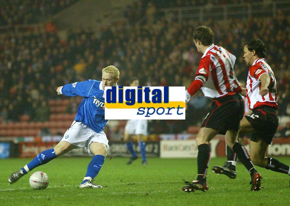 Photo. Andrew Unwin.<br /> Sunderland v Birmingham City, FA Cup Fifth Round, Stadium of Light, Sunderland 14/02/2004.<br /> Birmingham's Mikael Forssell (l) cannot get past the Sunderland defence of George McCartney (c) and Joachim Bjorklund (r).