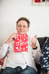 Portrait of mature man with Christmas present