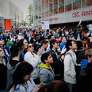 A crowd gathers outside the CBC studio in Vancouver enjoying a hockey playoff game in May of 2011. The Vancouver Canucks were victorious over the San Jose Sharks 3-2 advancing to the Stanley Cup Final for the first time in 17 long years.<br /> <br /> Photo: © Rod Mountain<br /> <br /> http://www.rodmountain.com
