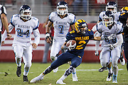 Milpitas wide receiver Devin Crummie, 2, shakes off the Valley Christian defense during Friday Night Lights at Levi's Stadium in Santa Clara, California, on September 18, 2015.  Milpitas went on to lose 22-21 against Valley Christian.  (Stan Olszewski/SOSKIphoto)