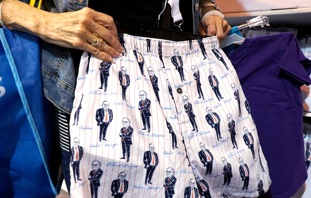 A Berkshire Hathaway shareholder looks over underwear for sale featuring images of CEO Warren Buffett and vice chairman Charlie Munger at the shareholder shopping day as part of the Berkshire Hathaway annual meeting weekend in Omaha, Nebraska May 5 2017. REUTERS/Rick Wilking