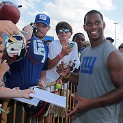 Victor Cruz posing for photographs and signing autographs with fans after training during the 2013 New York Giants Training Camp at the Quest Diagnostics Training Centre, East Rutherford, New Jersey, USA. 29th July 2013. Photo Tim Clayton. .