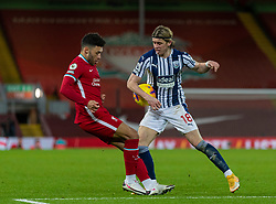 LIVERPOOL, ENGLAND - Sunday, December 27, 2020: Liverpool's Alex Oxlade-Chamberlain sees his shot blocked by the arm of West Bromwich Albion's Conor Gallagher, but no penalty or even a VAR review was awarded, during the FA Premier League match between Liverpool FC and West Bromwich Albion FC at Anfield. The game ended in a 1-1 draw. (Pic by David Rawcliffe/Propaganda)