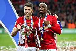 Michael Carrick and Paul Pogba of Manchester United celebrate with the EFL Trophy - Mandatory by-line: Matt McNulty/JMP - 26/02/2017 - FOOTBALL - Wembley Stadium - London, England - Manchester United v Southampton - EFL Cup Final