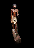 Ancient Egyptian wooden statue of Wepwawetemhat, Middle Kingdom, 12th Dynasty, (1939-1875 BC), Asyut, Tomb of Minhotep. Egyptian Museum, Turin. Cat 8786. black background .<br /> <br /> If you prefer to buy from our ALAMY PHOTO LIBRARY  Collection visit : https://www.alamy.com/portfolio/paul-williams-funkystock/ancient-egyptian-art-artefacts.html  . Type -   Turin   - into the LOWER SEARCH WITHIN GALLERY box. Refine search by adding background colour, subject etc<br /> <br /> Visit our ANCIENT WORLD PHOTO COLLECTIONS for more photos to download or buy as wall art prints https://funkystock.photoshelter.com/gallery-collection/Ancient-World-Art-Antiquities-Historic-Sites-Pictures-Images-of/C00006u26yqSkDOM