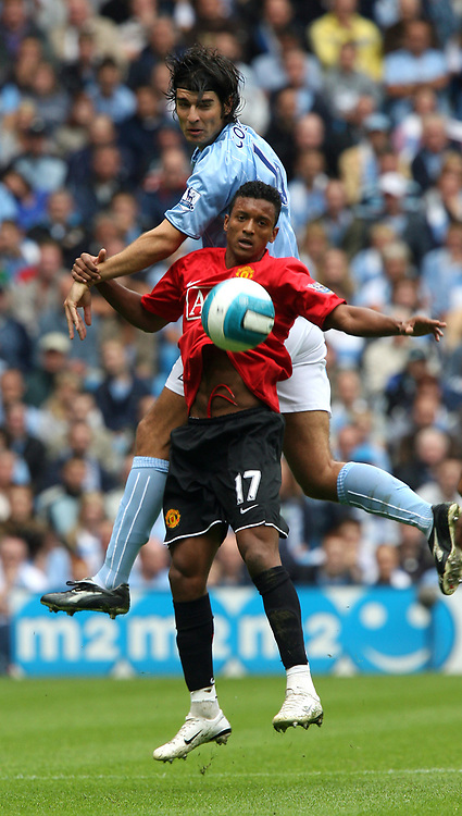 Photo: Paul Greenwood.<br />Manchester City v Manchester United. The FA Barclays Premiership. 19/08/2007.<br />Manchester City's Vedran Corluka, betas Nani in the air