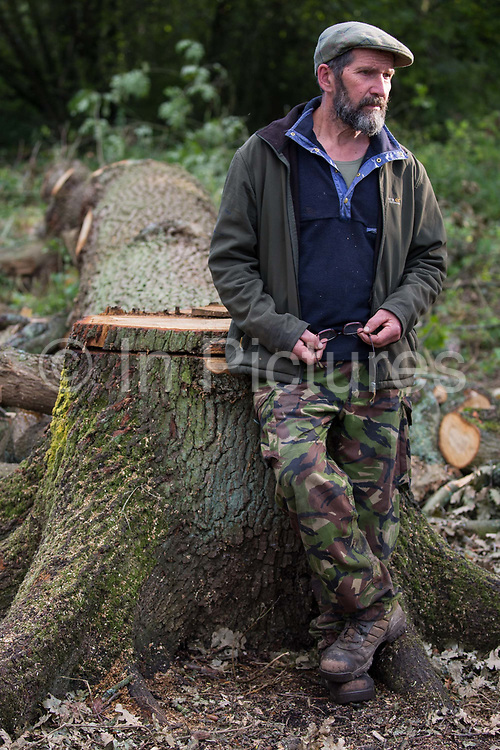 Environmental activist Mark Keir stands in front of a mature oak tree felled by tree surgeons working on behalf of HS2 Ltd in Denham Country Park for works connected to the HS2 high-speed rail link on 29 September 2020 in Denham, United Kingdom. Anti-HS2 activists based at the nearby Denham Ford Protection Camp, who are trying to prevent or delay the destruction of the woodland, contend that the area of Denham Country Park currently being felled is not indicated for felling on documentation supplied by HS2 Ltd.