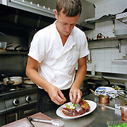 Chef Michael Smith preparing a lobster dish at The Three Chimneys Restaurant, Colbost on the Isle of Skye, Scotland, UK. Chef and director Michael Smith and his kitchen team, create dishes which reference Scotland's rich culinary heritage and wealth of ingredients. Their menus reflect the variety of Skye's natural larder from the land and sea.