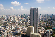 Daytime Bangkok skyline viewed from the 54th floor of the Lebua Hotel at State Tower in Silom district. Cars run through the city on the expressways below, and Bangkok's status as an highrise giant of Asia is unquestionable.