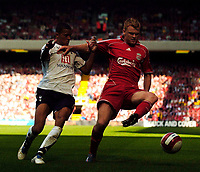 Photo: Jed Wee.<br />Liverpool v Tottenham Hotspur. The Barclays Premiership. 23/09/2006.<br /><br />Liverpool's John Arne Riise (R) takes on Tottenham's Jermaine Jenas.