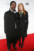 """December 6, 2012- New York, NY: (L-R) Actor Isaac Bankole and Julie Bankole attend the ' Keep A Child Alive Black Ball """" Redux """" 2012 ' held at the Apollo Theater on December 6, 2012 in Harlem, New York City. The Benefit pays homage to Oprah Winfrey, Angelique Kidjo for their philanthropic contributions in Africa and worldwide and celebrates the power of woman and the promise of an AIDS-free Africa. (Terrence Jennings)"""
