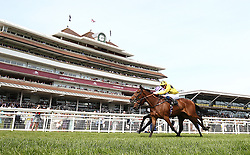 Orin Swift ridden by Rob Hornby wins the Starlight Wishes Handicap Stakes at Newbury Racecourse.